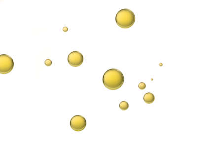 Yellow olive oil bubbles isolated over a white background