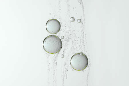 Water bubbles floating over a gray and blurred background