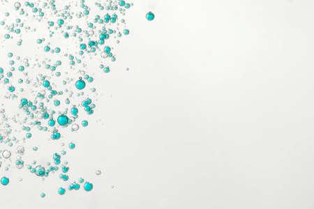 BLue fizz bubbles flowing over a light background