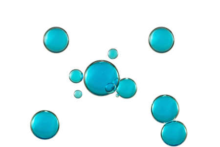 Beautiful blue glowing bubbles isolated over the white background. Imagens
