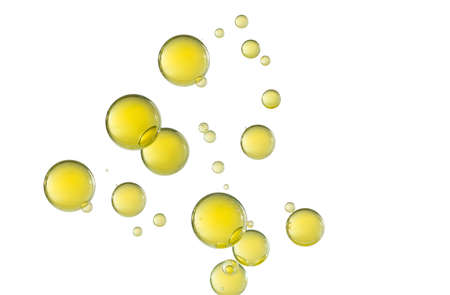 Many light yellow bubbles isolated over a white background. Imagens