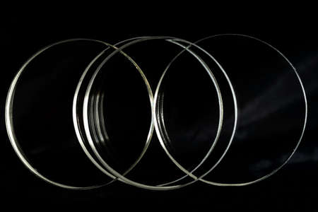 Illuminated rings is isolaed over a black background Imagens - 101150908