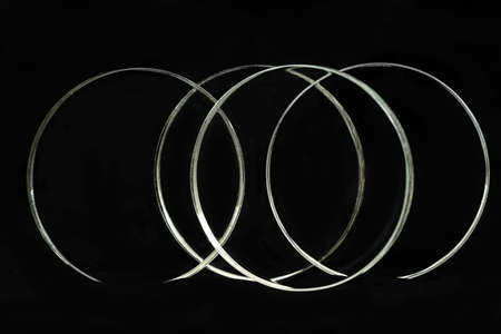 Illuminated rings is isolated over a black background.