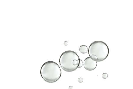 A group of water bubbles is isolated over a white background. Imagens - 101183414
