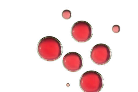 Beautiful red bubbles is isolated over a whjite background. Imagens - 103586039