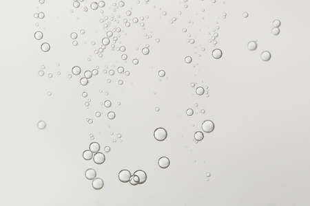 Beautiful champagne fizz bubbles in a crystal glass. Banco de Imagens