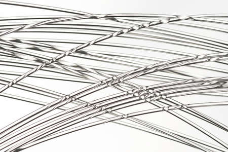 Twisted fiber cables isolated over a light background.