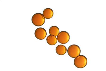 A group of orange bubbles over a white surface. 스톡 콘텐츠
