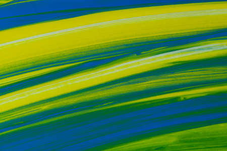 A linear pattern in green, blue and yellow.