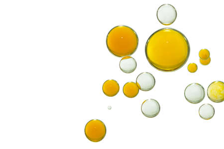 Yellow and clear transparent liquid bubbles, isolated over a white background 写真素材