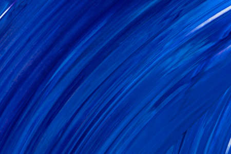 A blue surface with slightly curves lines.