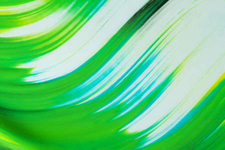 Green wave pattern flows over a white background. 写真素材