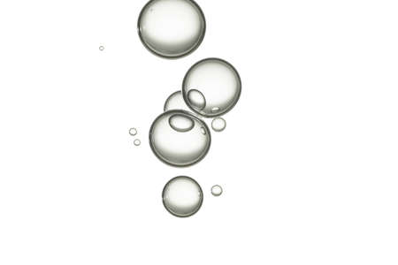 Beautiful water bubbles flows over a clear background.