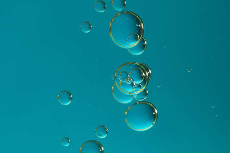 Flowing blue water bubbles with small glitter dots.