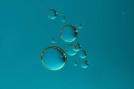A group of gradient blue oxygen bubbles.