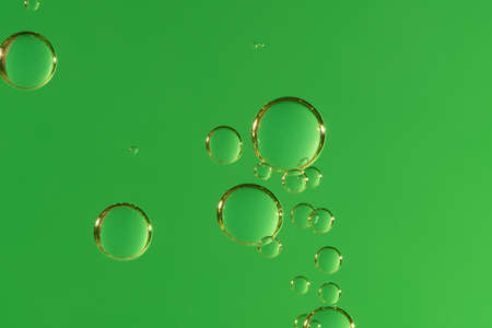 Beautiful air bubbles soars over a massive green background.