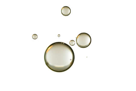 A group of golden bubble is isolated over white.
