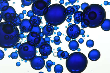 Blue water bubbles rises toward the surface.
