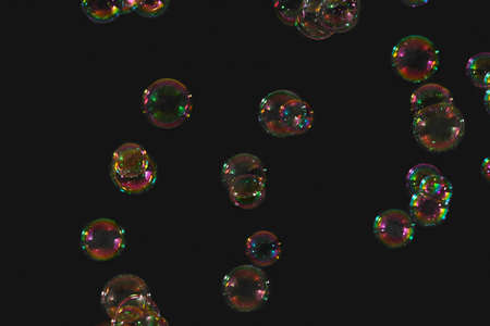 Colorful soap bubbles flying over a white background. 免版税图像
