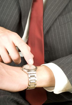 impatient: impatient business man pointing on his watch Stock Photo
