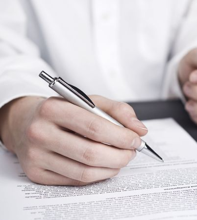 business man carefully reading a contract Stock Photo