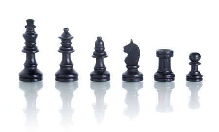complete set of chess pieces isolated on white with reflection