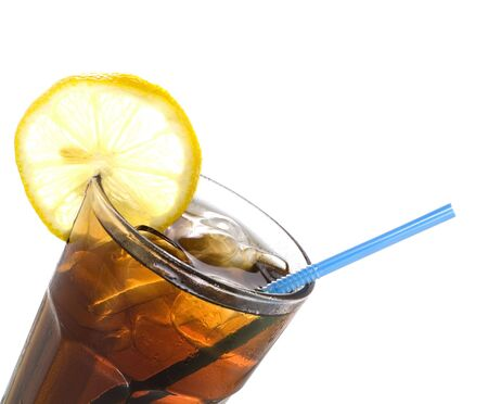 glass of cola with lemon and straw