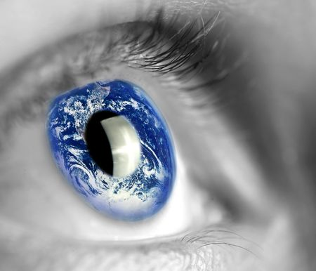 eyes open: earth globe in womans eye