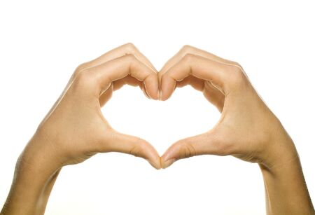 hands forming a heart on white background Stock Photo