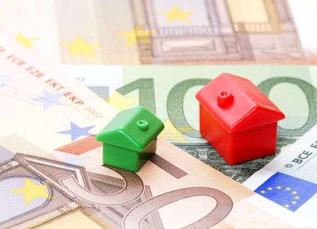 personal finance: houses and euro bills Stock Photo