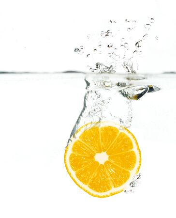orange jumping into water