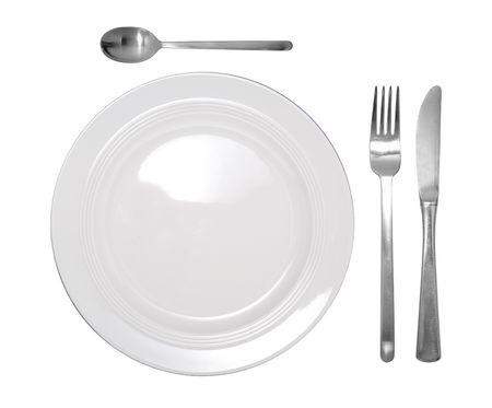 cuchillo y tenedor: establecimiento de un lugar que contiene un plato, cuchillo, tenedor y cuchara