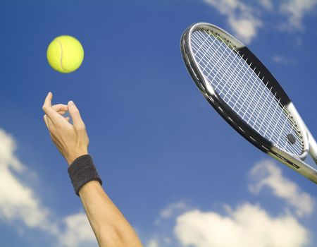 tennis player tossing up the ball