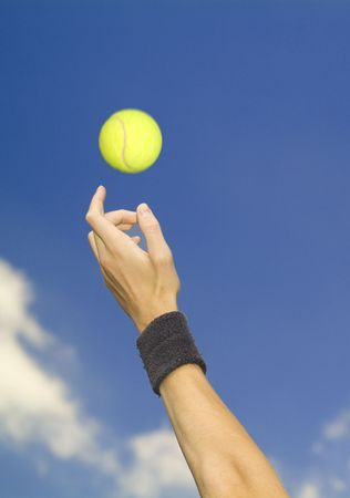 tennis player tossing up ball