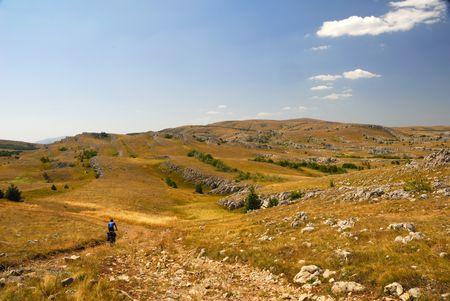 Biker on mountain plateau. ( Plateau Carabi in Krimea, Ukraine) photo