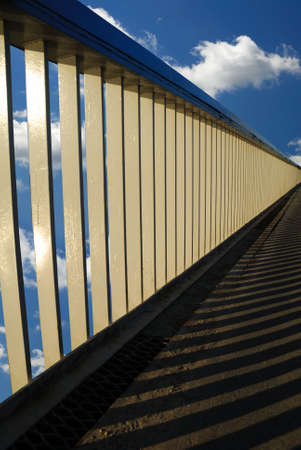 brige: railing of brige and clouds on background Stock Photo
