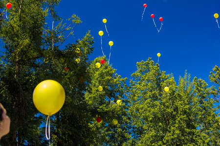 yellow balloon flies into the blue sky after the rest