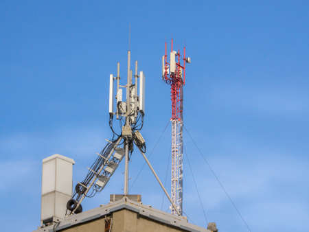 Telecommunication base stations network repeaters on the roof of the building