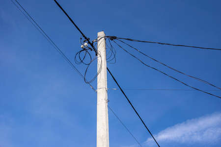 overhead cable and electrical cable on the pole