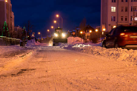 snow removal from the streets with heavy road equipment Stok Fotoğraf