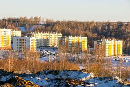 Completion of the construction of a new neighborhood on the outskirts of the city, near a forest or surrounded by a park