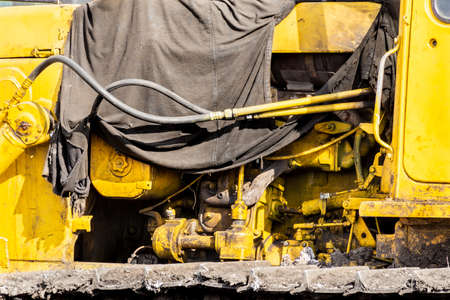 the engine compartment of the caterpillar tractor is covered with an oiled tent