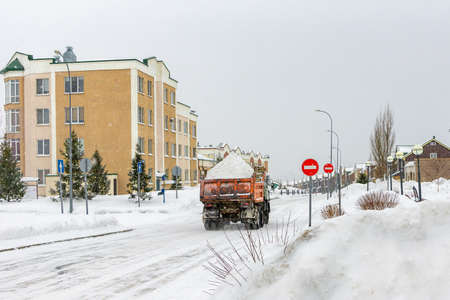 snow removal and removal by truck, including on official driveways and under prohibition signs