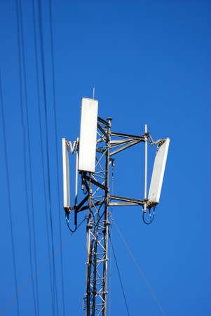 Communications antennas against blue sky Stock Photo - 2774060