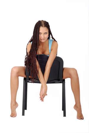 sitting beautiful girl in little blue dress. long legs Stock Photo - 3324466
