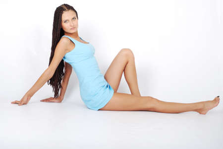 sitting beautiful girl in little blue dress. long legs Stock Photo - 3324465