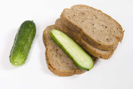 Cucumbers And Bread Isolate On White photo