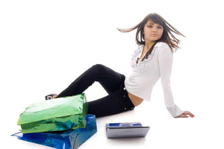 Girl, Notebook and Two Shopping Bags photo