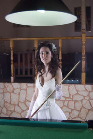 Cute Brunette Bride Playing Billiard photo