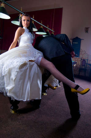 Long Legs Bride And Groom Playing Billiard. photo